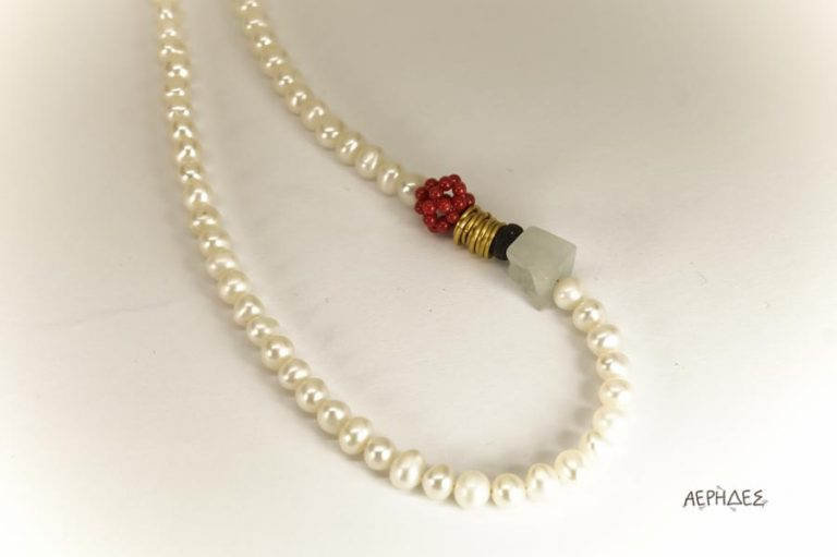 handmade pearl necklace with brass,red coral,lava and an aquamarine.Close up
