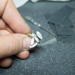 finishing a silver ring by hand